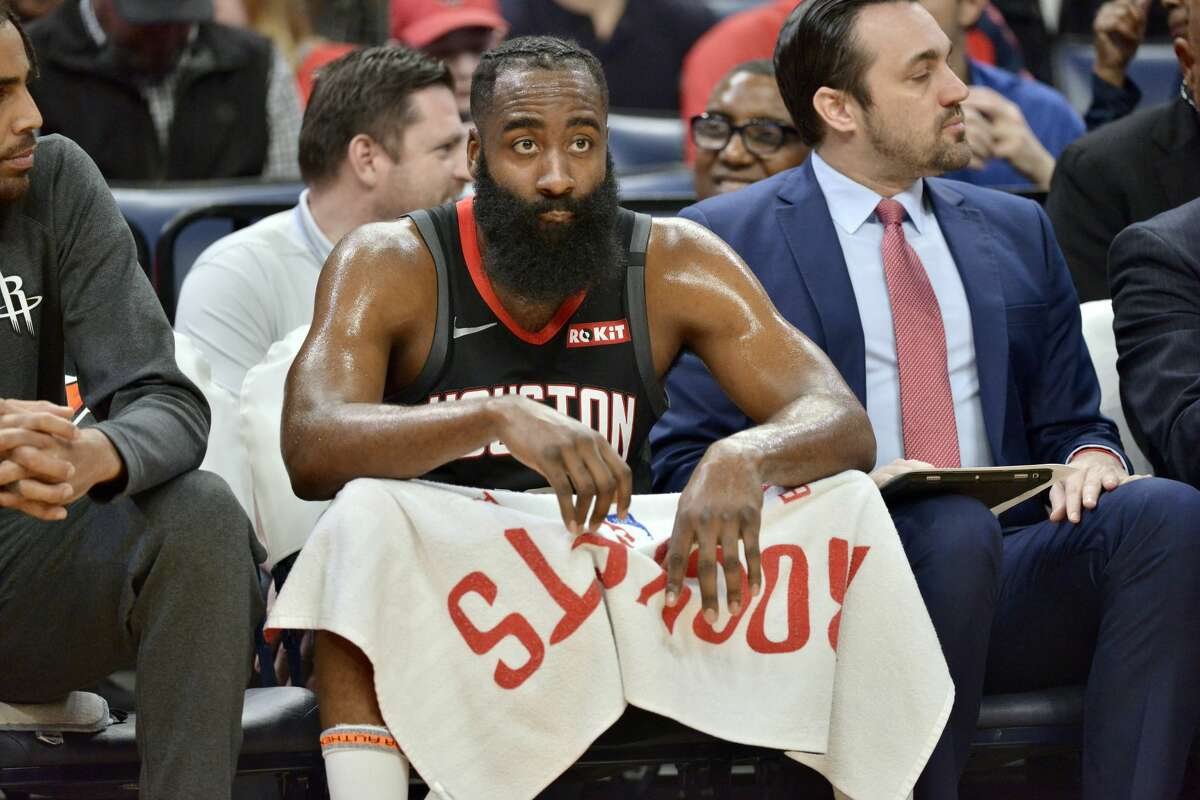 Houston Rockets guard James Harden sits on the bench in the first half of an NBA basketball game against the Memphis Grizzlies Tuesday, Jan. 14, 2020, in Memphis, Tenn. (AP Photo/Brandon Dill)