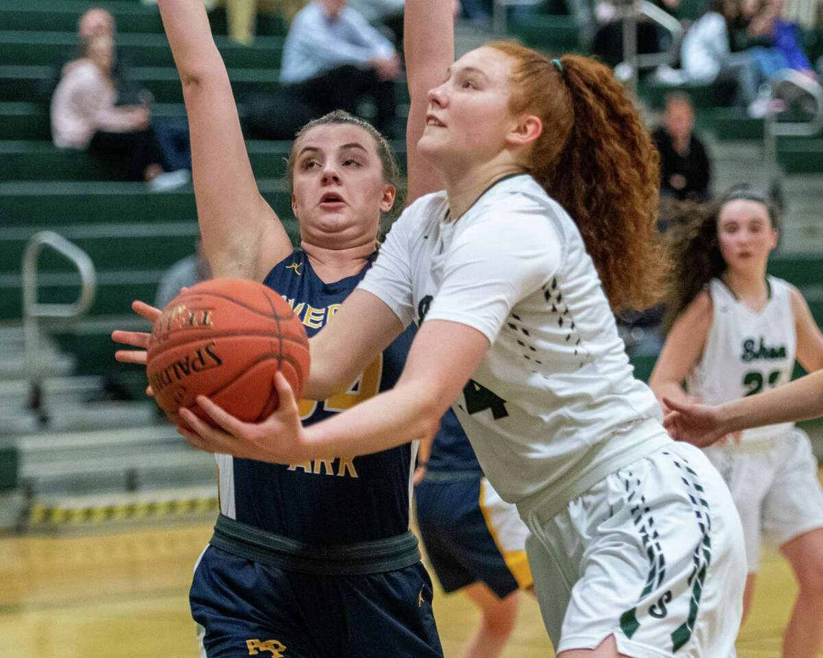 Shenendehowa junior Bella Stuart drives to the basket in front of Averill Park senior Kelsey Wood during a Suburban Council game at Shenendehowa High School on Tuesday, Jan. 14, 2019 (Jim Franco/Special to the Times Union.)