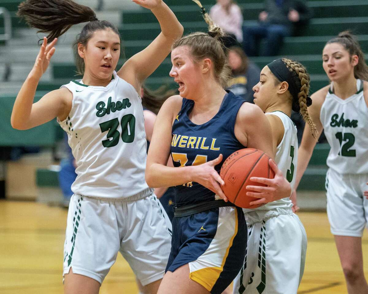 Averill Park senior Kelsey Wood grabs a rebound in front of Shenendehowa junior Sam Lee (30) and senior Simone Walker (3) during a Suburban Council game at Shenendehowa High School on Tuesday, Jan. 14, 2019 (Jim Franco/Special to the Times Union.)