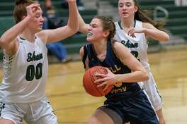 Averill Park junior Anna Jankovic drives to the basket in front of Shenendehowa sophomore Jillian Huerter during a Suburban Council game at Shenendehowa High School on Tuesday, Jan. 14, 2019 (Jim Franco/Special to the Times Union.)