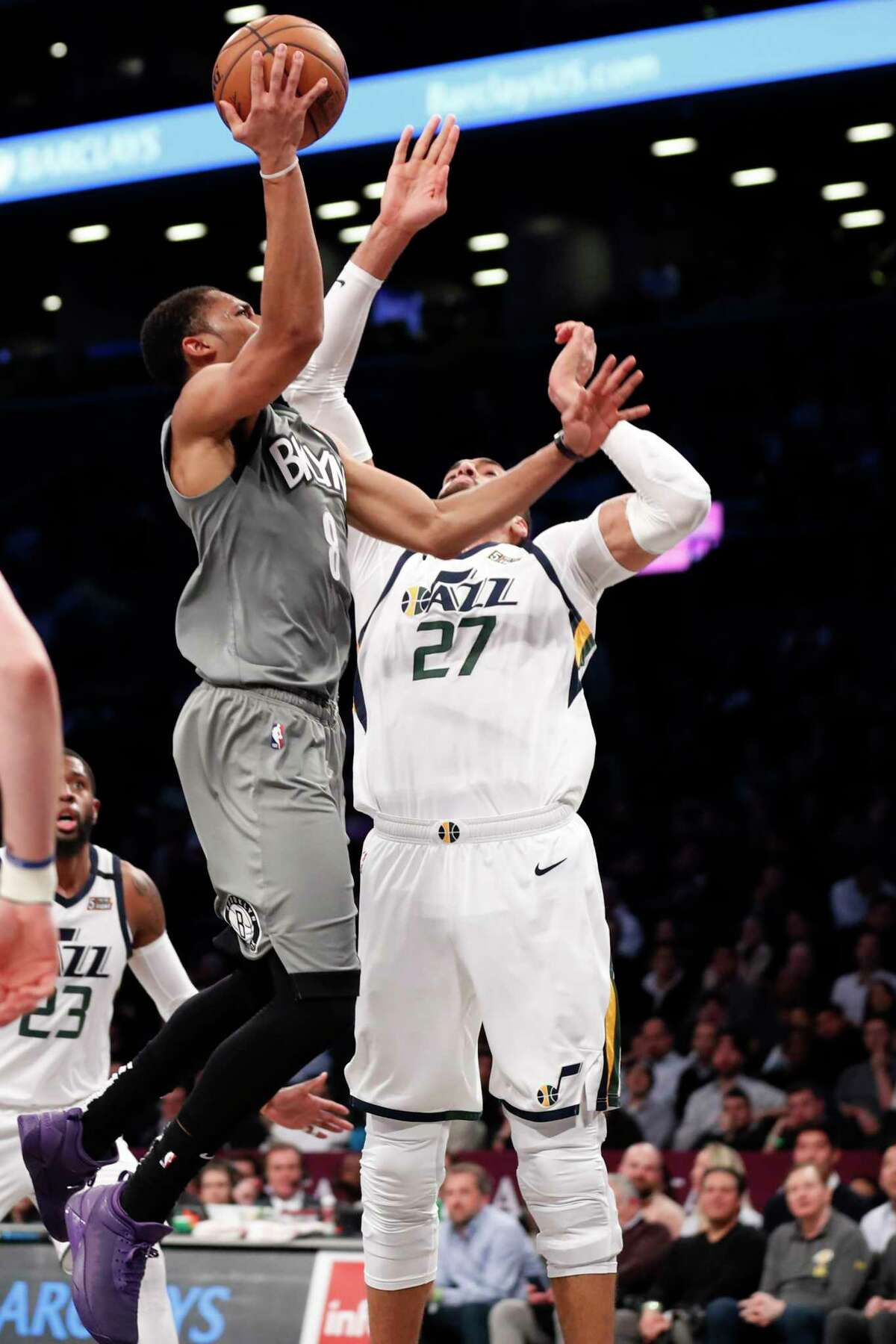 Utah Jazz center Rudy Gobert (27) defends as Brooklyn Nets guard Spencer Dinwiddie (8) shoots during the second quarter of an NBA basketball game Tuesday, Jan. 14, 2020, in New York. (AP Photo/Kathy Willens)