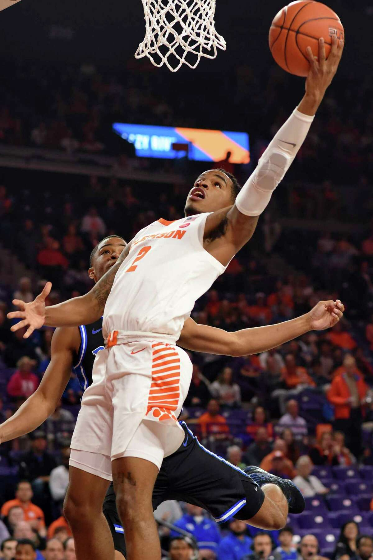 Clemson's Al-Amir Dawes, front, shoots while defended by Duke's Cassius Stanley during the first half of an NCAA college basketball game against Duke Tuesday, Jan. 14, 2020, in Clemson, S.C. (AP Photo/Richard Shiro)