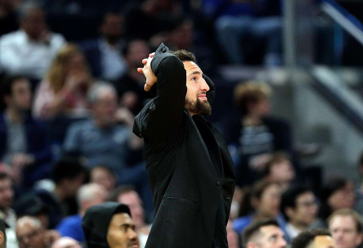 Klay Thompson (11) reacts to a foul call against Eric Paschall (7) in the first half as the Golden State Warriors played the Dallas Mavericks at Chase Center in San Francisco, Calif., on Tuesday, January 14, 2020.