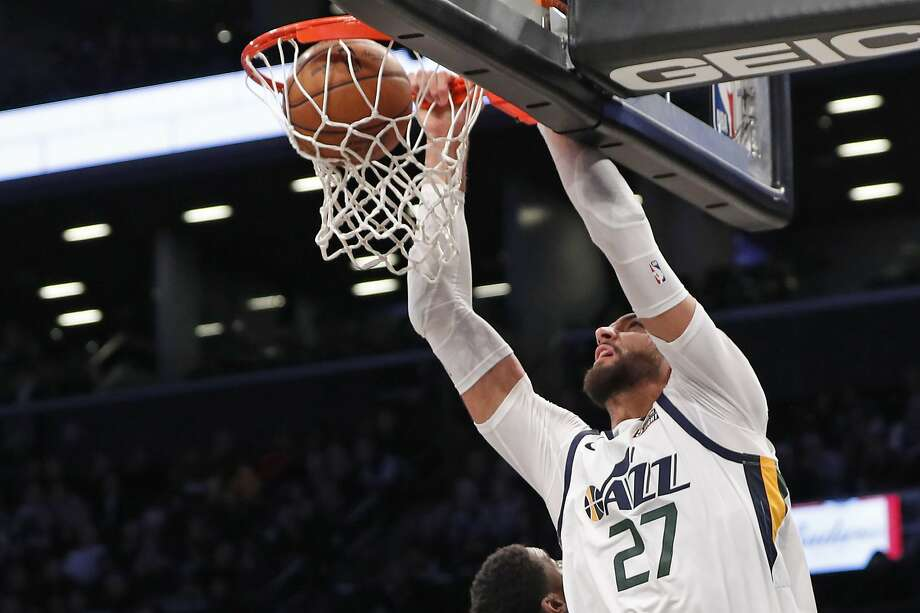 Jazz center Rudy Gobert dunks during the second half. He had 22 points and 18 rebounds in the win. Photo: Kathy Willens / Associated Press