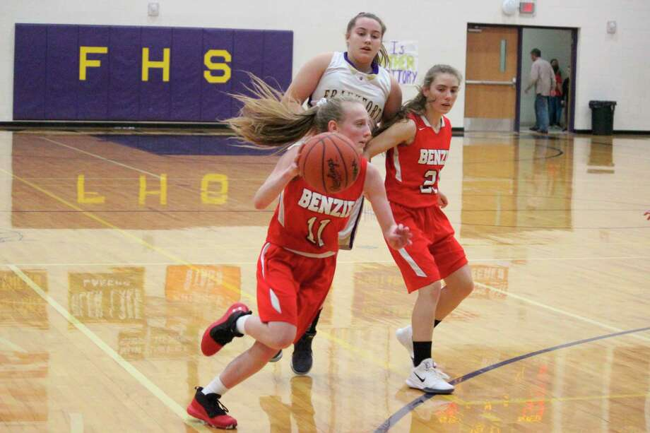 Bailey Price drives to the basket late in Friday's victory over Frankfort. (Photo/Robert Myers)