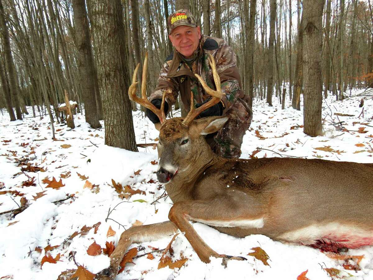 Evart's Mark Sochocki bagged an 8-point buck on his farm during the rifle season. (Courtesy photo)