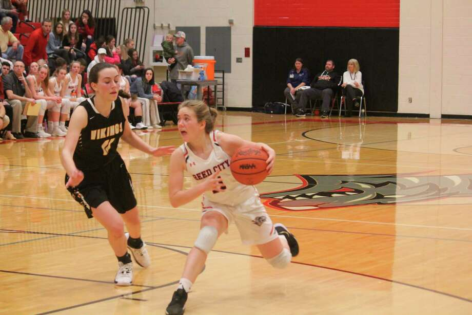 Reed City's Paige Lofquist looks to make a move against Tri County on Friday. (Herald Review photo/John Raffel)