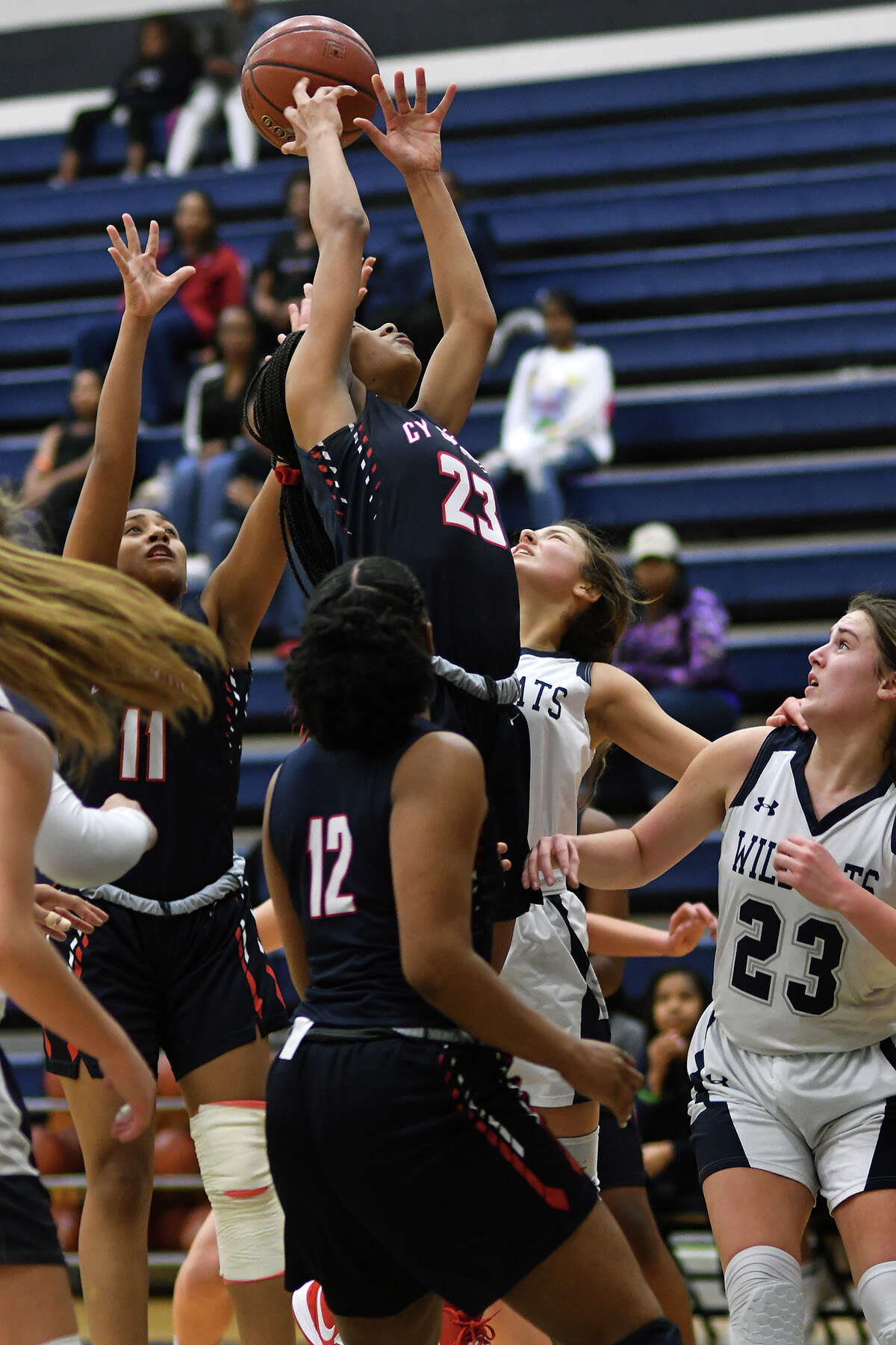 Cy Springs junior forward Aniah Wade (23) skies for a rebound against Tomball Memorial sophomore forward Madyson McMunn (23) during the second quarter of their District 14-6A matchup at TMHS on Jan. 14, 2020.