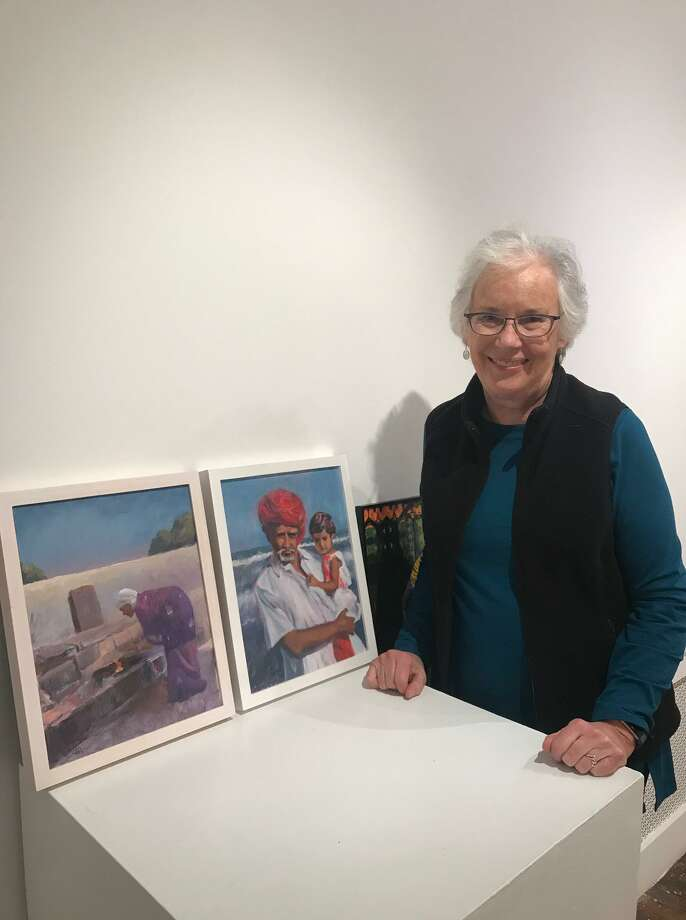 "Member artist, Alice Hayes, with her submissions for the ""Compassion"" Show at the Guild, inspired by a trip to India last year. Photo: Contributed Photo"