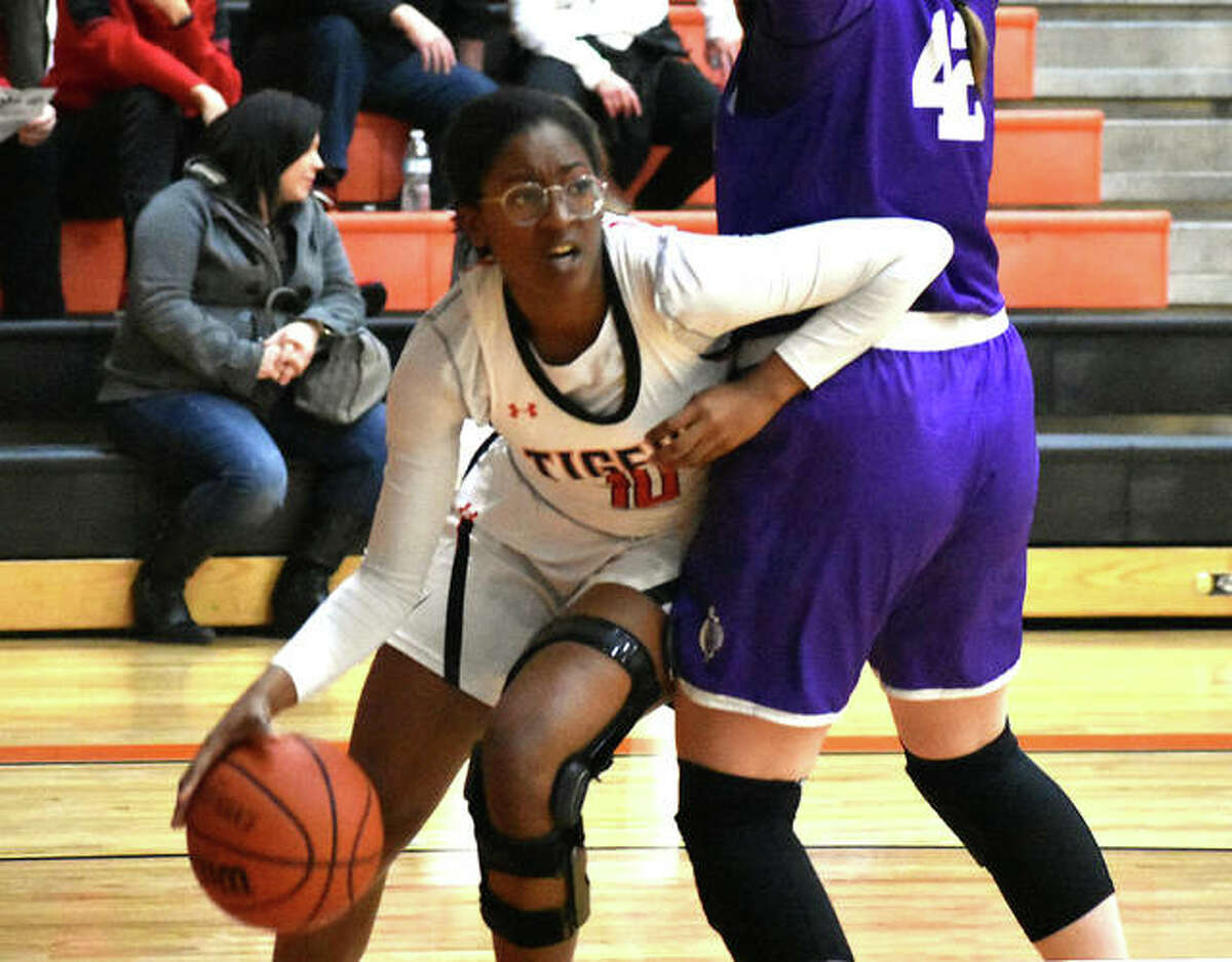Edwardsville forward Amanda Mills tries to drive baseline before being cut off by a Collinsville defender in the fourth quarter Tuesday inside Lucco-Jackson Gymnasium.