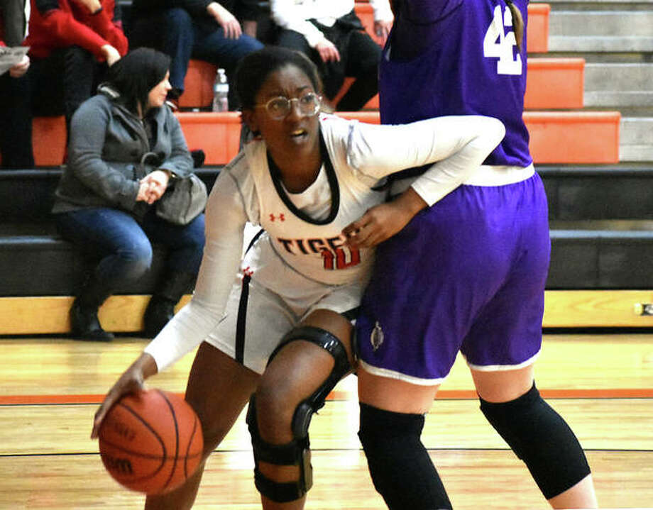 Edwardsville forward Amanda Mills tries to drive baseline before being cut off by a Collinsville defender in the fourth quarter Tuesday inside Lucco-Jackson Gymnasium. Photo: Matt Kamp|The Intelligencer