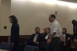 Paul Barbaritano, right in a white shirt, the 52-year-old Albany man accused of killing a woman last summer, appears in Albany County Court on Wednesday