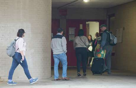 Classes are canceld at Bellaire High School, but teachers and staff return to school after a student was shot on campus and later died at the hospital on Wednesday, Jan. 15, 2020, in Bellaire.
