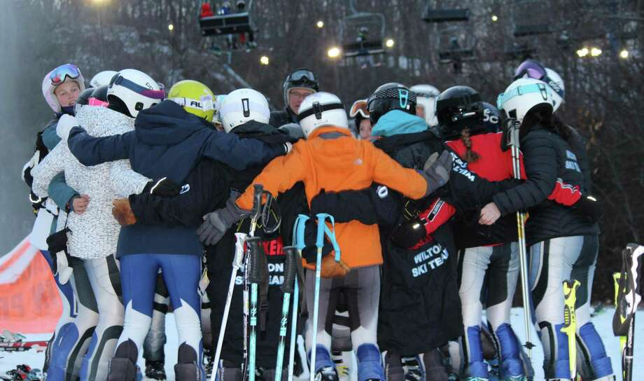 The Wilton girls ski team gathers around coach Bill Howard at last week's season-opening race. Photo: Wilton Ski Team / Contributed Photo