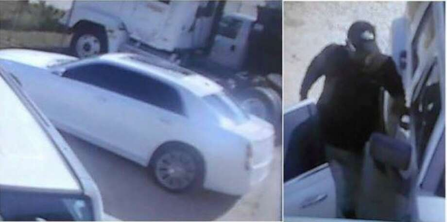 A man is seen on surveillance camera footage stepping out of a vehicle in December to allegedly burglarize a vehicle in New Caney. The vehicle he was in is also pictured. Photo: Courtesy Of The Montgomery County Sheriff's Office