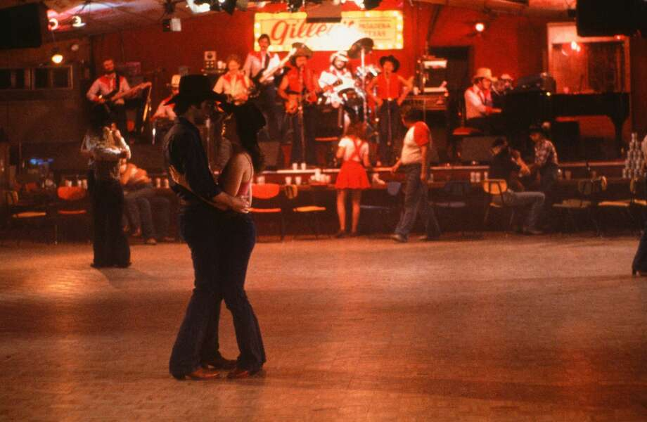 "CIRCA 1980: Actor John Travolta and Debra Winger dance at Gilley's in a scene during the Paramount Pictures movie 'Urban Cowboy"" circa 1980. (Photo by Hulton Archive/Getty Images) Photo: Getty Images  / 2014 Getty Images"
