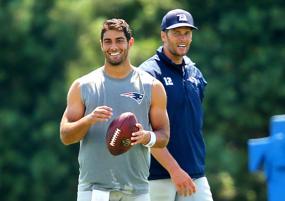 Jimmy Garoppolo and Tom Brady hang out after practice to work together on some long passes. The photo was snapped at New England Patriots training camp on the practice fields behind Gillette Stadium in Foxborough, Mass. on August 3, 2016. Photo: John Tlumacki/The Boston Globe Via Getty Images