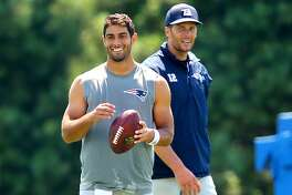 Jimmy Garoppolo and Tom Brady hang out after practice to work together on some long passes. The photo was snapped at New England Patriots training camp on the practice fields behind Gillette Stadium in Foxborough, Mass. on August 3, 2016.
