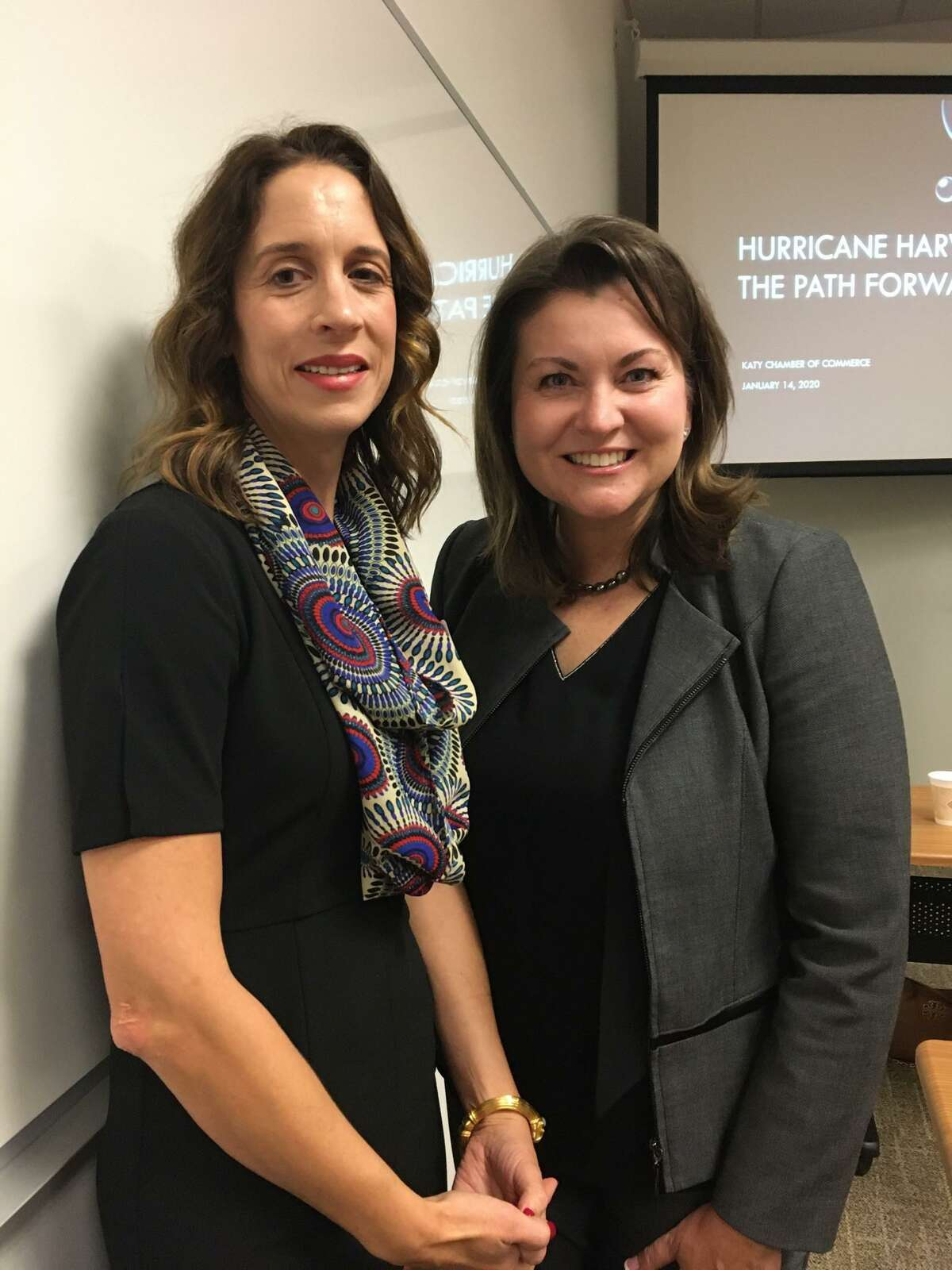 Wendy Duncan, right, Willow Fork Drainage District assistant vice president, talks with Melissa Washington, Texas General Land Office community outreach coordinator for Austin, Brazoria, Fort Bend, Galveston and Waller counties, prior to the Jan. 14 Katy Area Chamber of Commerce Luncheon. Duncan, the keynote speaker, talked about Hurricane Harvey and the Path Forward.