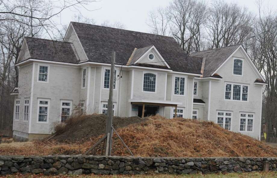 With construction financing straightened out, the house at 197 Branchville Road is expected to move soon from fairly complete to done and on the market, according to attorney Raymond Lemley of Branford, who represents the builders. Photo: Macklin Reid / Hearst Connecticut Media