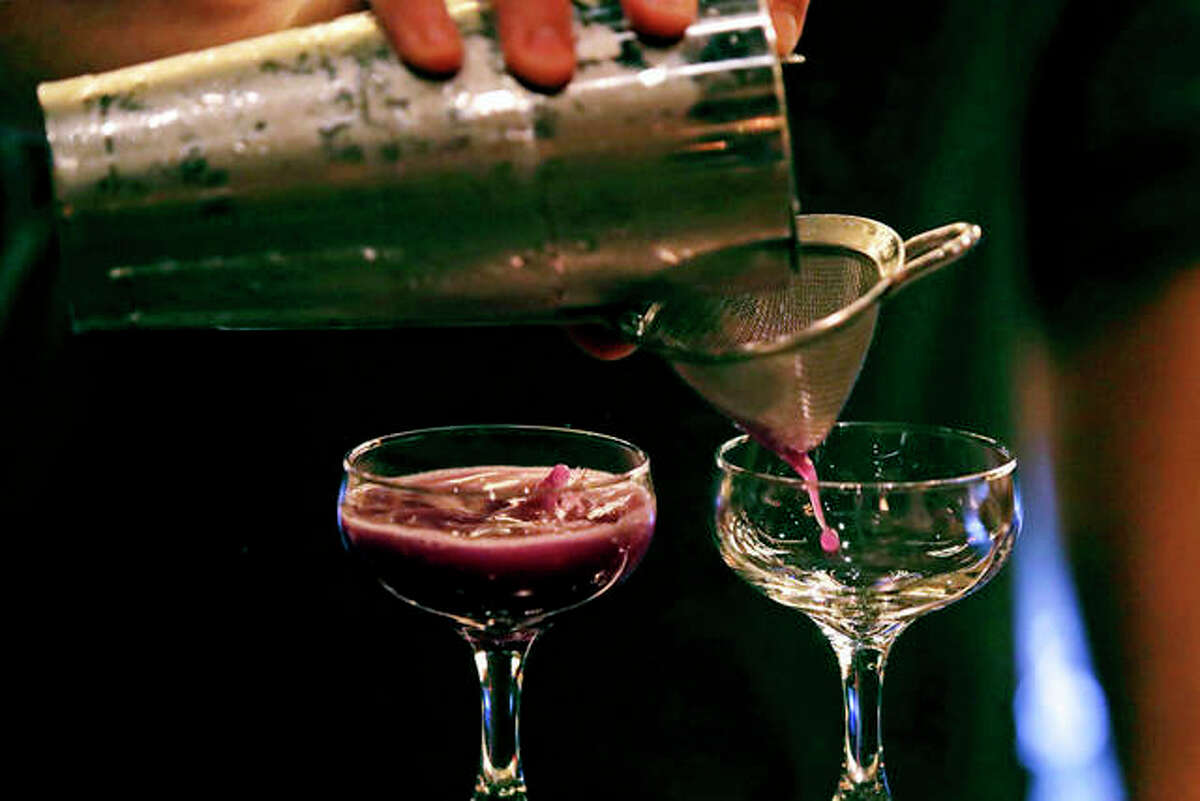 Cocktails are crafted at Wink & Nod, a basement-dwelling, speakeasy-like bar, in Boston. Americans are consuming more alcohol per capita now than in the time leading up to Prohibition, when alcohol opponents successfully made the case that excessive drinking was ruining family life. Charles Krupa | AP