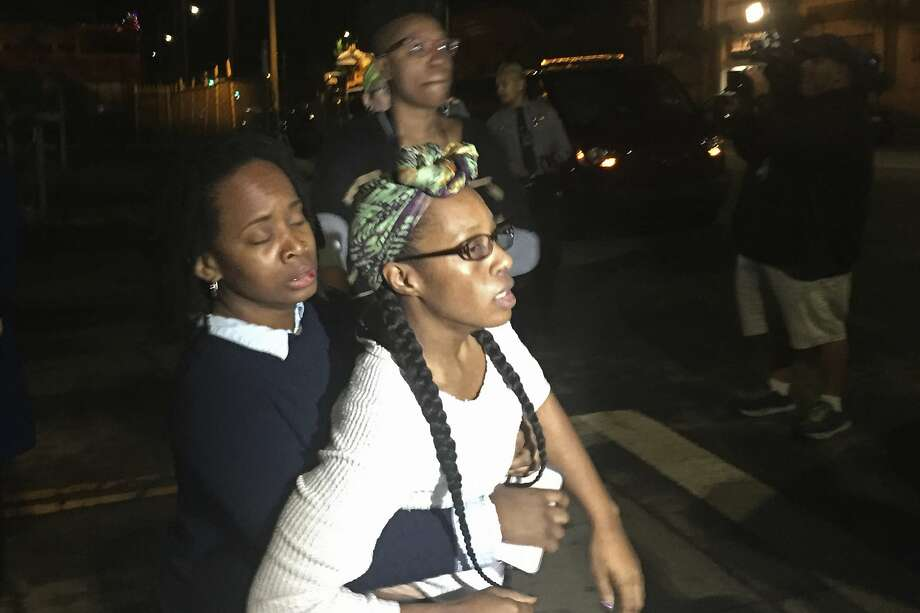 Carroll Fife, regional director of Alliance of Californians for Community Empowerment, left, holds back Moms 4 Housing founder Dominique Walker, who is distraught over the arrests of her fellow members and former housemates Tuesday, Jan. 14, 2020, in Oakland, Calif. Homeless women ordered by a judge last week to leave a vacant house they occupied illegally in Oakland for two months have been evicted by sheriff's deputies. They removed two women and a male supporter Tuesday from the home before dawn in a case highlighting California's severe housing shortage and growing homeless population. (Marisa Kendall/ Bay Areas News Group via AP) Photo: Marisa Kendall, Associated Press