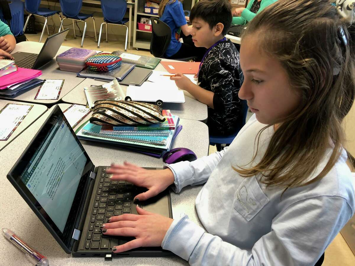 Perry Hill School students Laney Graham and Derek Castanada do work on their Chromebooks last school year.