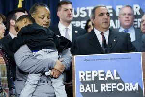 Sheila Harris, left, of Stony Point, holds her son, C.J. Johnson, 4, at a press conference at the Legislative Office Building on Wednesday, Jan. 15, 2020, in Albany, N.Y.  Harris was there to talk about her cousin, Maria Osai, a mother of three, who was hit and killed by an unlicensed hit-and-run driver in Rockland County on Christmas Eve. The driver was released without bail. Those attending the press conference were calling on Democrats to repeal the bail reform changes that were enacted January 1st.     (Paul Buckowski/Times Union)