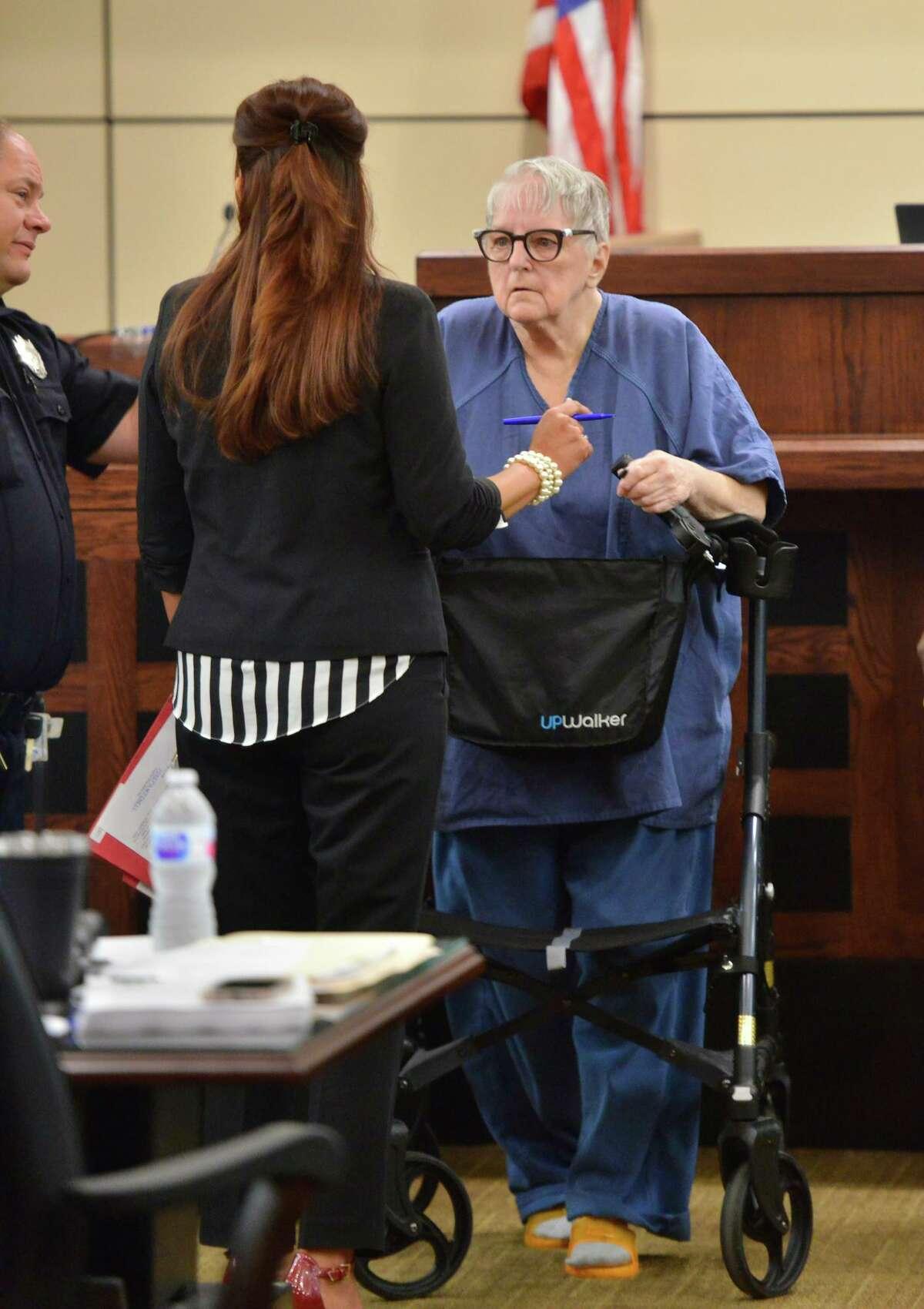 Genene Jones leaves court with her attorney Brigitte Garza Sept. 9, 2019.