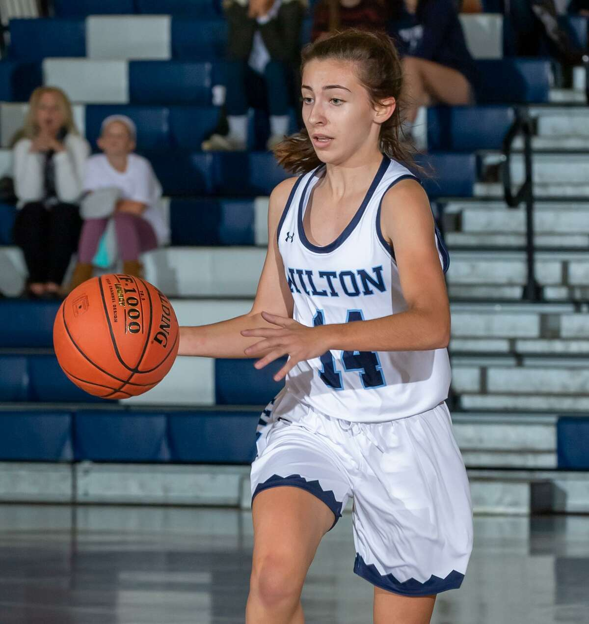 Leah Martins and the Wilton girls hoop team play at Suffield in the first round of the state tournament.