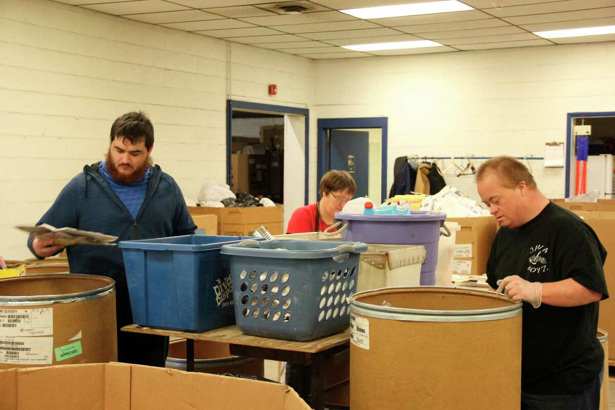 Some of the Thumb Industries Clients go through recycled materials. Thumb Industries' Recycling Program is in danger of shutting down to due changes in funding sources. (Robert Creenan/Huron Daily Tribune)