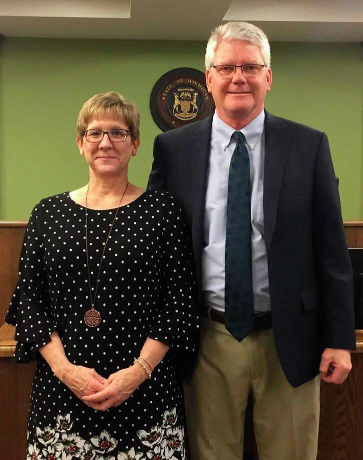 After spending more than 35 years working for the county, Elaine Moorepictured here withChief Judge David Herrington, has decided to retire. (Courtesy Photo)