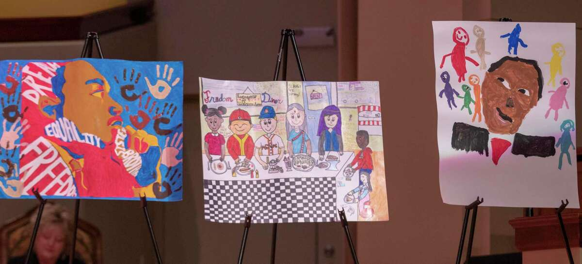 Poster art made by area elementary students is lined up along the stage during the annual Dr. Martin Luther King Jr. Celebration on Monday, Jan. 21, 2019 at The Woodlands United Methodist Church.