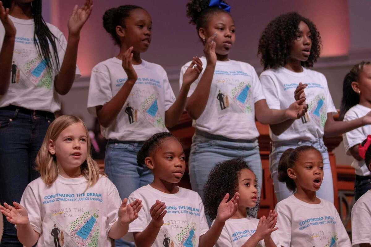 Members of the Children's Mass King Choir sing