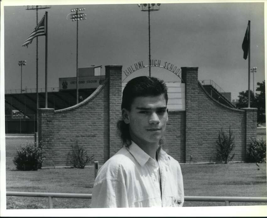 Jeremy Toth stands outside of Boerne High School. He was told he could attend as a regular student because of his long hair.
