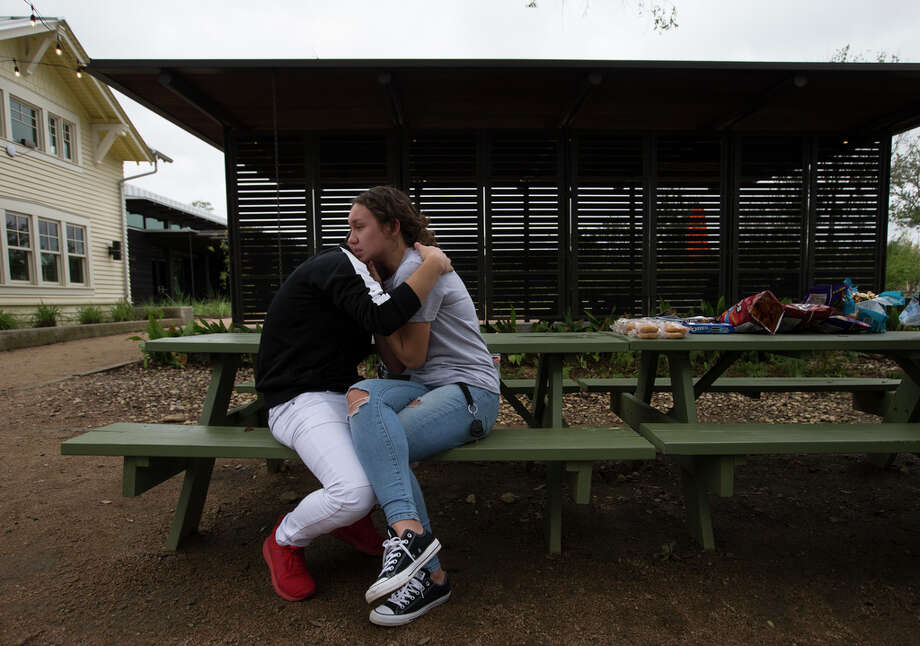 Bellaire High School students Emin Cruz, 16, and Grace Bandercan, 18, console each other at the gathering to remember the student who was shot and killed yesterday on campus at Evelyn Park on Wednesday, Jan. 15, 2020, in Bellaire.  The victim was in the JROTC, and was shot by another JROTC student. Photo: Yi-Chin Lee, Staff Photographer / © 2020 Houston Chronicle