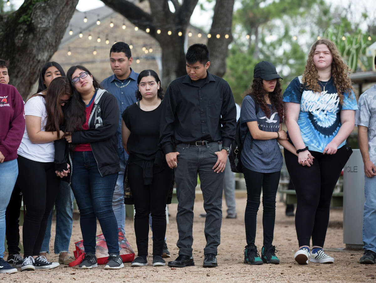 Bellaire High School students and former students gather in a circle to share their memories of the student who was shot and killed yesterday on campus at Evelyn Park on Wednesday, Jan. 15, 2020, in Bellaire.
