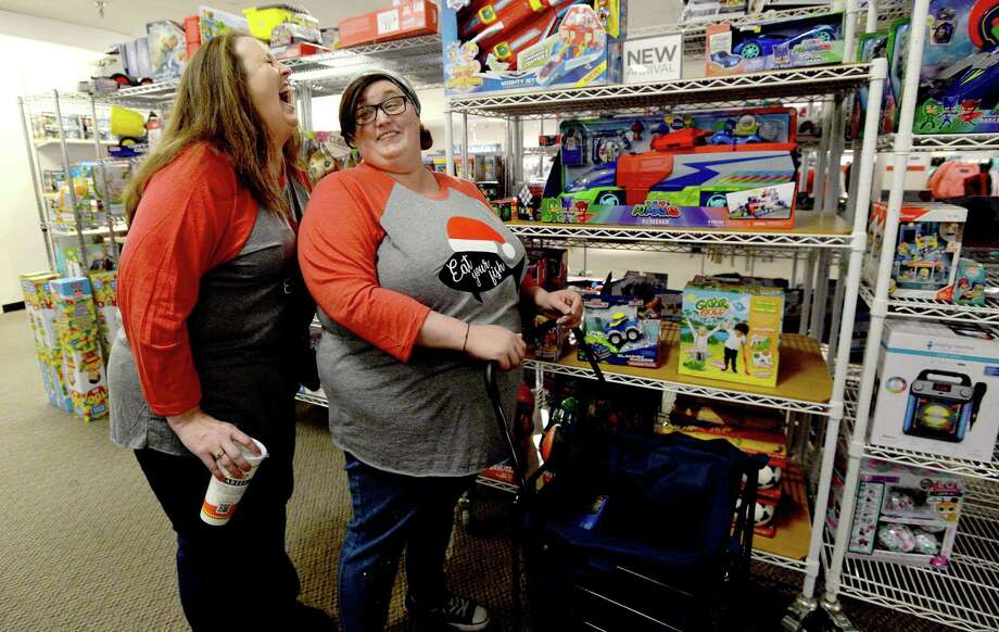 Nikki Barron and Amber Garcia joke with one another as they enjoy their family shopping tradition on Black Friday at the J. C. Penney store in Parkdale Mall. Photo taken Friday, November 29, 2019 Kim Brent/The Enterprise Photo: Kim Brent / The Enterprise / BEN