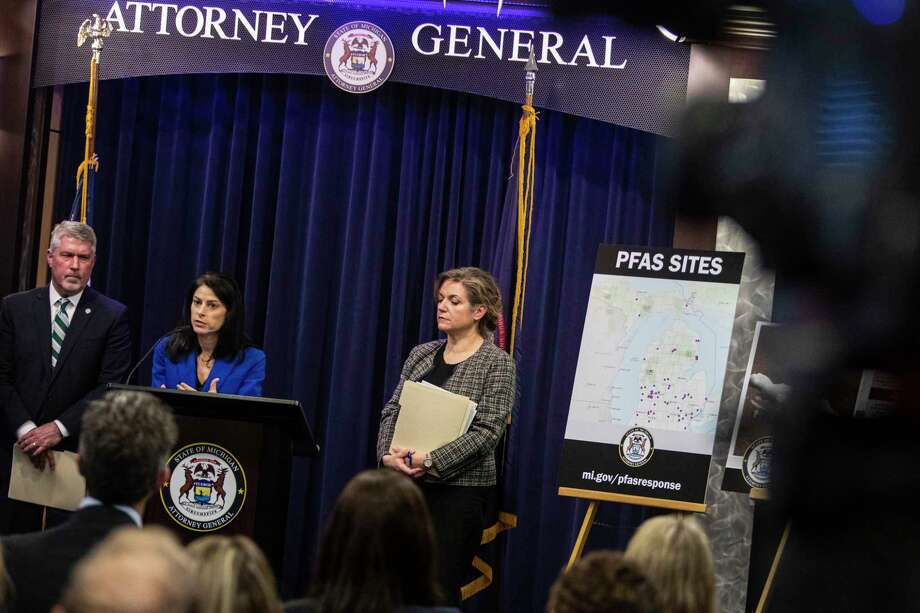 Michigan Attorney General, Dana Nessel, second left, announces a lawsuit against 17 PFAS manufacturers at the Attorney General's officeon Jan. 14 in Lansing. (Joel Bissell/MLive.com/Kalamazoo Gazette via AP) / © Joel Bissell | MLive.com 2020
