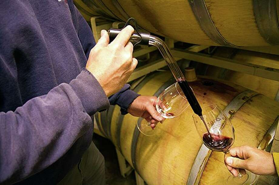 "A ""wine thief"" - which is pictured - is a glorified pipette with a finger hold at the top and a narrow inlet/outlet at the tube bottom. The glass tube narrow inlet/outlet is inserted into the oak wine barrel via the bung hole on the side of the oak barrel with the wine rising up inside the glass tube. Photo: Courtesy Photo"