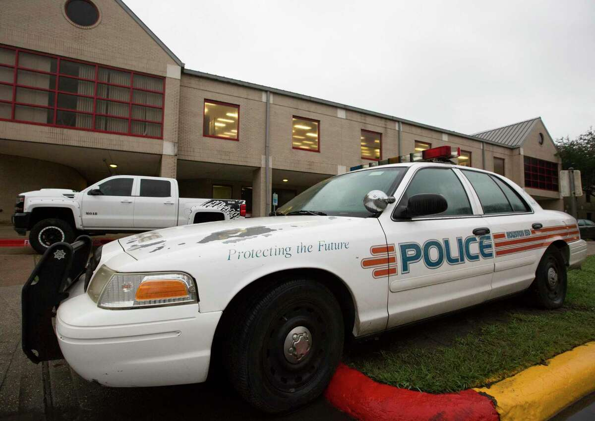 A Houston ISD police car is parked outside Bellaire High School in January, when a student was shot on-campus and later died at the hospital. Several social justice organizations are calling on HISD leaders to disband the district's police department, arguing students are less safe overall with officers at schools.