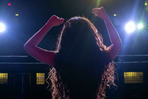 """Jillian Sainz practices before the final round of auditions for the Woodlawn Theatre's staging of """"On Your Feet!"""" She was one of five finalists to play music superstar Gloria Estefan in the musical."""