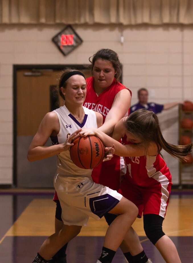 Elaiyna Schwartzkopf pulls down a rebound for Calvary Baptist in its win over Juniata on Tuesday. Photo: Mo Pix Pro Media