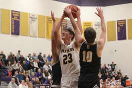 Jack Stefanski draws contact on the foul on his way to the basket in the first half of Frankfort's loss to Glen Lake.