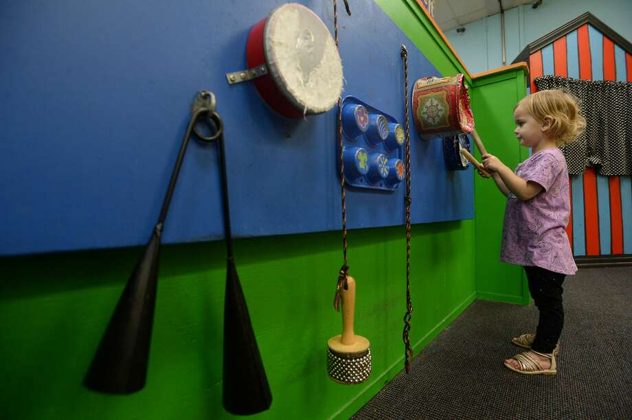 Adella Lynn checks out a wall of instruments as she and family play inside the Beaumont Children's Museum Tuesday afternoon. City council discussed Tuesday the possible move of the museum into the former Sears warehouse on Magnolia Street, which the city has owned and used for storage for several years. The move would double their programming and on-site storage capabilities. Photo taken Tuesday, Jan. 14, 2020 Kim Brent/The Enterprise Photo: Kim Brent/The Enterprise
