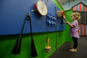 Adella Lynn checks out a wall of instruments as she and family play inside the Beaumont Children's Museum Tuesday afternoon. City council discussed Tuesday the possible move of the museum into the former Sears warehouse on Magnolia Street, which the city has owned and used for storage for several years. The move would double their programming and on-site storage capabilities. Photo taken Tuesday, Jan. 14, 2020 Kim Brent/The Enterprise