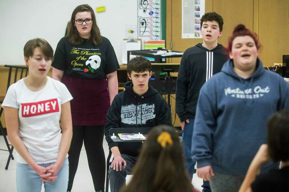 From left, Midland High School senior Arianna Perez, senior Hannah Duford, sophomore George Hageage, sophomore Joey Maslowski and junior Meghan Campbell sing a song Friday during a rehearsal for their upcoming Cabaret show. (Katy Kildee/kkildee@mdn.net)