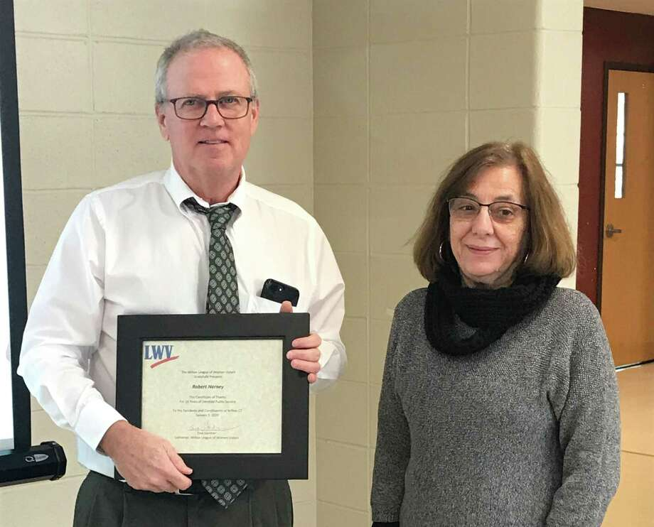 Tina Gardner, convener of the Wilton League of Women Voters, presents a Certificate of Apprectiation to outgoing Wilton Planning Director Bob Nerney, thanking him for his years of service to the town. Photo: Virgina Gunther /Contributed Photo / Wilton Bulletin Contributed