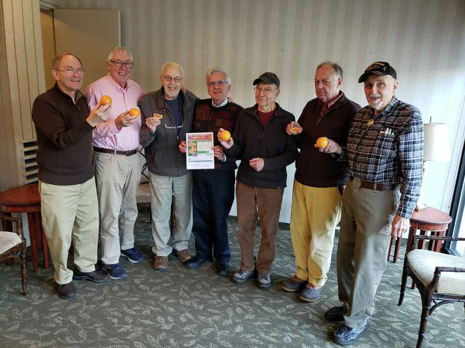 "From left, Kiwanians Jerry Sperole, Marty Clancy, Bud Taylor, Bill Brautigam, Dave Hapke, Den Taylor and Fred ""Hans"" Sindel get ready for the club's annual citrus sale which begins Jan. 20. Photo: Contributed Photo / Kiwanis Club Of Wilton / Wilton Bulletin Contributed"
