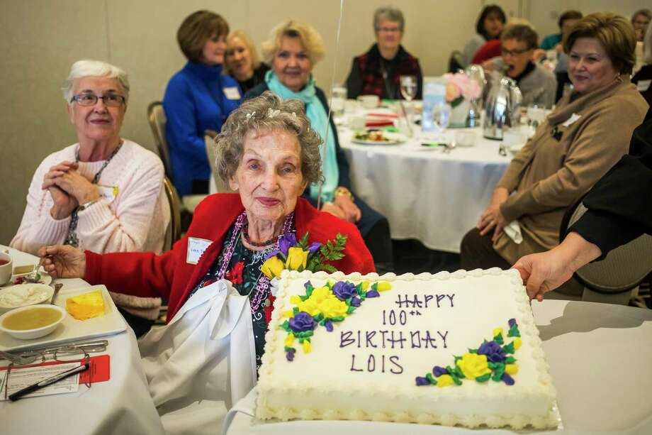 Lois Peterson poses for a photo with her birthday cake as fellow members of the Midland Christian Women's Connection celebrate Peterson's upcoming 100th birthday during a gathering of the group Wednesday at Midland Country Club. (Katy Kildee/kkildee@mdn.net)